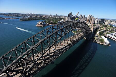 An aerial view of the Sydney Harbour Bridge as the sunlight shimmers on the water below. photo