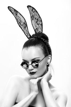 beautiful nude women: Stylish, beautiful girl model in an image of a rabbit Stock Photo