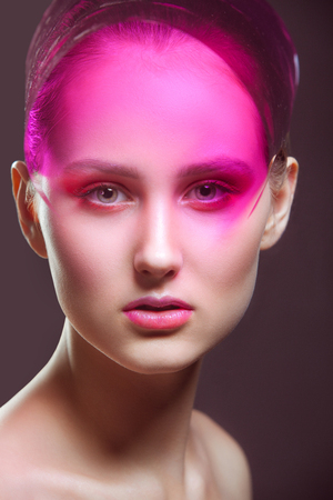 fantasy makeup: Fashion-portrait of the young girl with a fantasy make-up in pink tones