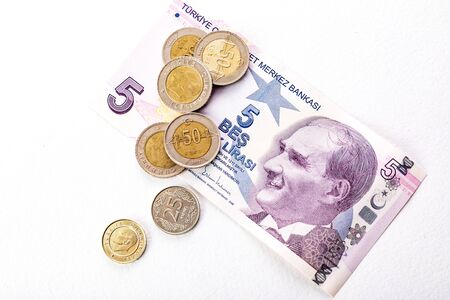 Turkish banknotes and coins. Turkish Lira or TL on white background.