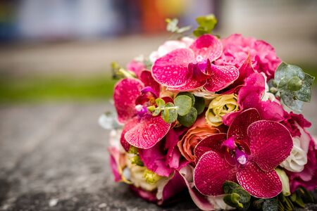 Beautiful bouquet of fresh flowers on a stone slab.