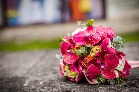 Beautiful bouquet of fresh flowers on a stone slab.