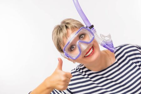 Cheerful girl in a mask for swimming on a white background.