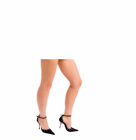 Beautiful female legs in high-heeled shoes. Legs of a young girl on a white background. Stock Photo