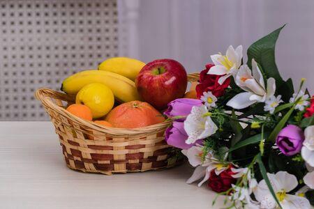 Fruit in a basket. Apple, bananas, oranges. Dietary nutrition.