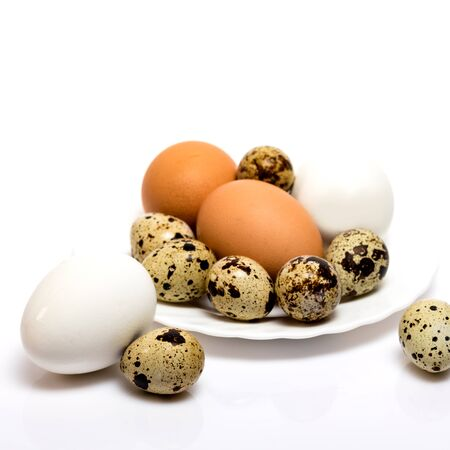 Boiled chicken and quail eggs were placed on a Breakfast plate on a white background.