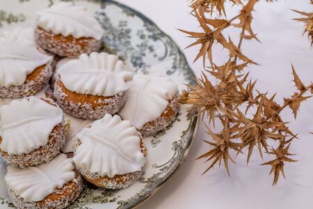 Butter cookies with icing and coconut shavings.