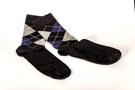 Men's socks on a white background. An item of clothing for men.