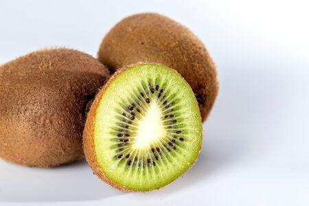 Delicious ripe kiwis on white