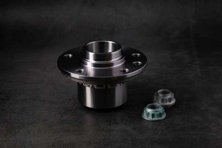 The wheel hub bearing car on a background of black marble.Concept of new spare parts and car repairs. Stock fotó