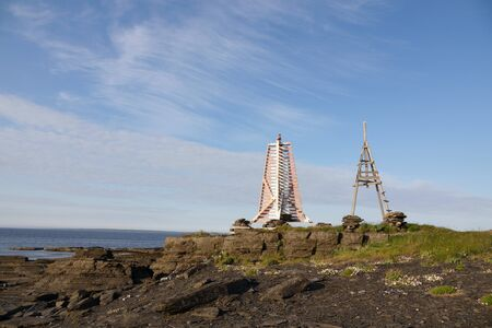 Old and new lighthouse on the Arctic ocean in summer Stockfoto - 132086349