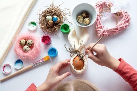 schoolgirl is make wickerwork of beads and eggs