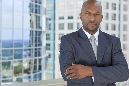 Successful African American businessman or man in a suit in a modern city