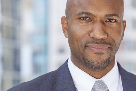 Happy smiling successful African American businessman or man in a suit in a modern city Stock Photo - 19360123