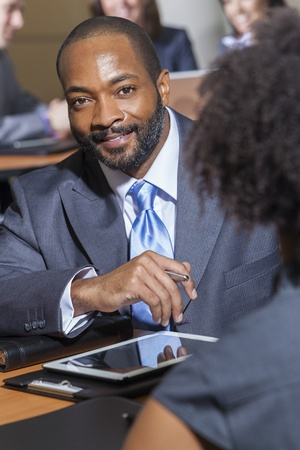 african businessman: An African American businessman in a meeting with businesswoman colleague Stock Photo