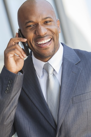 Successful African American businessman or man in a suit in a modern city talking on his cell phone Stock Photo - 19445855