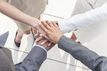 Overhead view of business team of businessman and businesswomen, men & women, hands together deal making agreement Stock Photo - 19483550