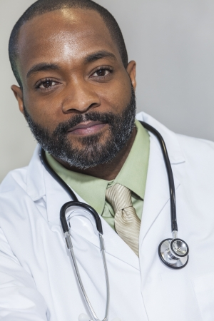 african american man: African American man male hospital doctor in white coat with stethoscope Stock Photo