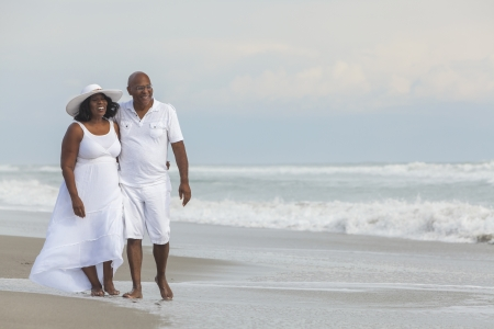 married couples: Happy romantic senior African American man and woman couple on a deserted tropical beach
