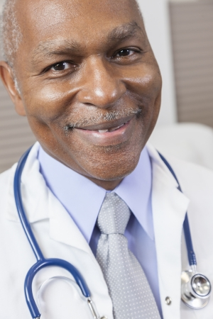 A senior African American male doctor wearing a shirt, tie and stethoscope