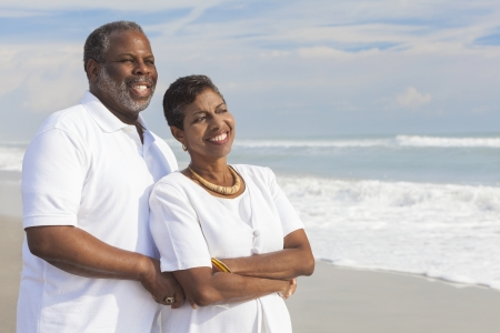 healthy seniors: Happy romantic senior African American man and woman couple on a deserted tropical beach