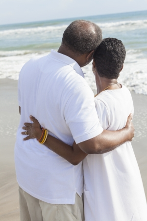 Rear view of romantic senior African American man and woman couple on a deserted tropical beach