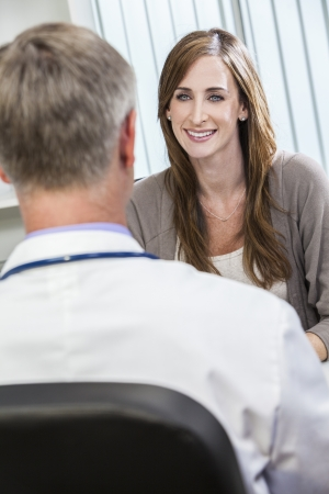 doctor appointment: Male medical doctor seeing happy smiling female patient or colleague
