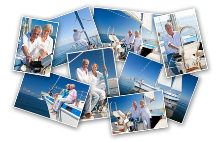 A happy retired senior couple sailing a sail boat or yacht on a calm blue sea, smiling and laughing together photo
