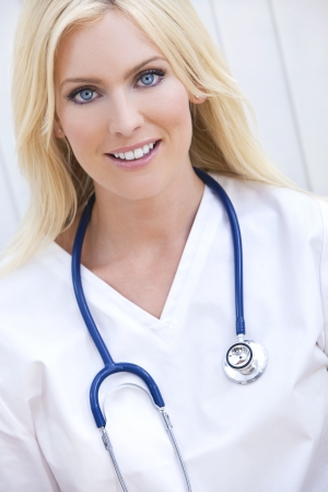 Happy, smiling, female hospital doctor or nurse with stethoscope  photo