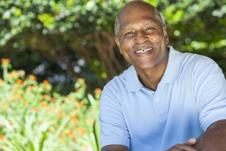 old man: A happy senior African American man in his sixties outside smiling.