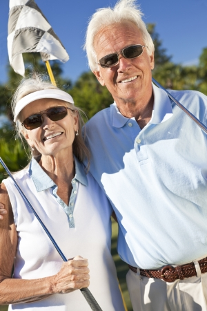 Happy senior man and woman couple together playing golf  photo