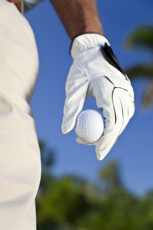 golf glove: Close up on male golfers gloved hand holding a golf ball Stock Photo