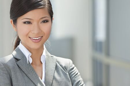 business suit: Outdoor portrait of a beautiful young Asian Chinese woman or businesswoman in smart business suit