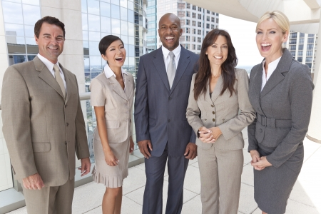 coworker: Happy laughing interracial group of business men & women, businessmen and businesswomen team