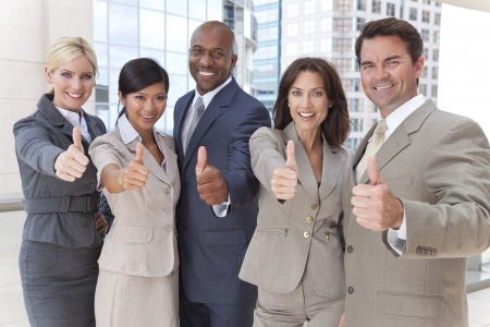 Successful positive interracial group of business men & women, businessmen and businesswomen team, giving thombs up Stock Photo - 19524543
