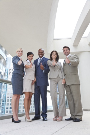 Successful positive interracial group of business men & women, businessmen and businesswomen team, giving thombs up Stock Photo - 19524534