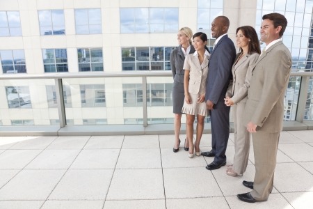 Interracial group of business men & women, businessmen and businesswomen team Stock Photo - 19524545