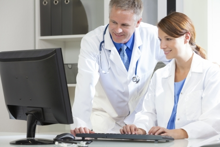 doctor computer: Male & female medical doctors using computer in a hospital office Stock Photo
