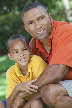 A happy African American man and boy, father and son photo