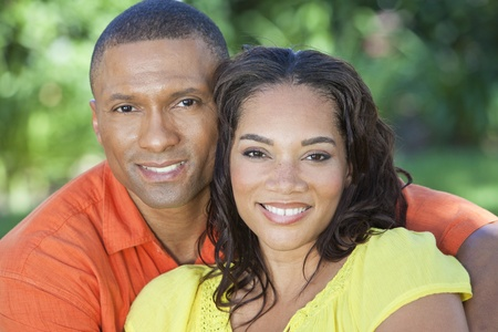 A young African American woman   man couple outside in the summer photo