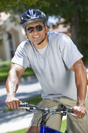 A fit and healthy African American man riding bicycle in the summer  Stock Photo - 19608584