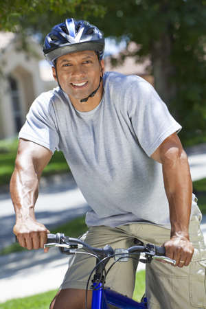 An African American man couple riding bicycle in the summer photo