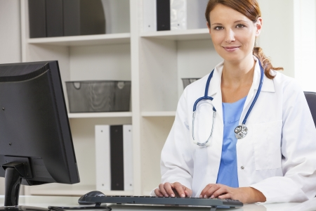 doctor's office: Woman female medical doctor using computer in her hospital office