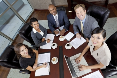 Interracial group of business men   women, businessmen and businesswomen team meeting in boardroom photo