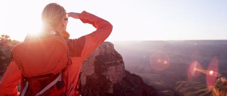 visions of america: A woman hiker looking at the Grand Canyon, Arizona, USA