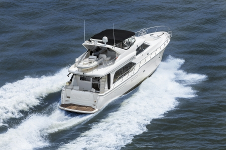 Aerial photograph of luxury power boat yacht speedboat on blue sea Stock Photo