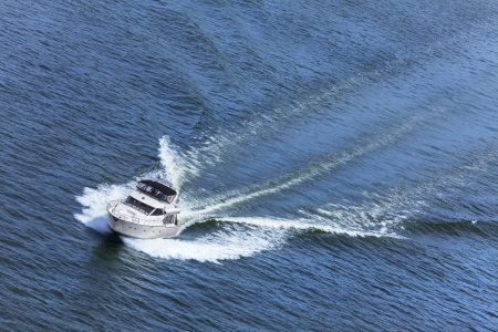power boat: Aerial photograph of luxury power boat yacht speedboat on blue sea Stock Photo