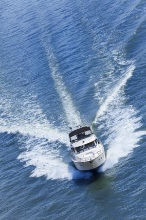 speedboat: Aerial photograph of luxury power boat yacht speedboat on blue sea Stock Photo