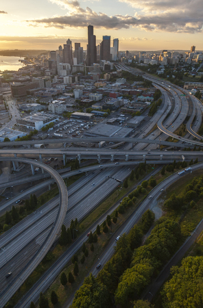 Aerial photograph of City Skyline and freeway road system in Seattle, Washington, USA