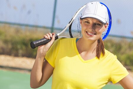Beautiful happy girl or young woman laughing smiling and playing tennis